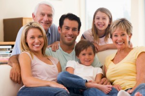 Extended family in living room smiling ready for estate planning